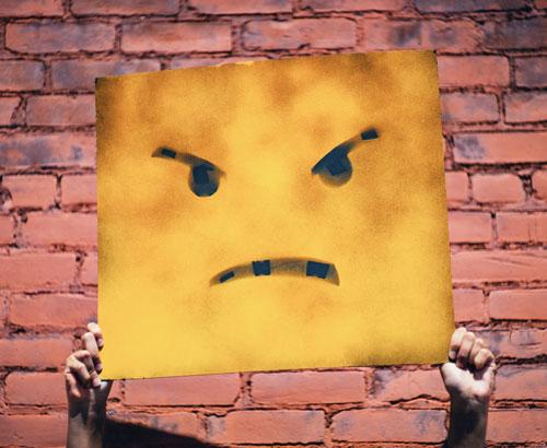 Cartel con una cara de enfado y frustración.